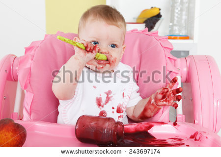 stock-photo-naughty-baby-eating-alone-in-the-high-chair-243697174