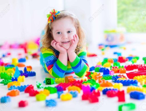 preschooler-child-playing-with-colorful-toy-blocks-kids-play-with-educational-toys-at-kindergarten-o-stock-photo