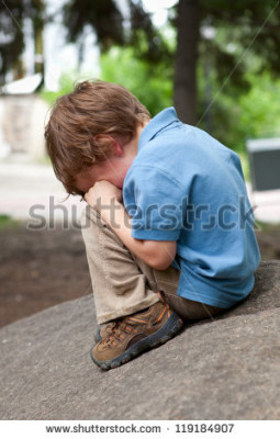stock-photo-small-child-sits-on-stone-in-park-119184907